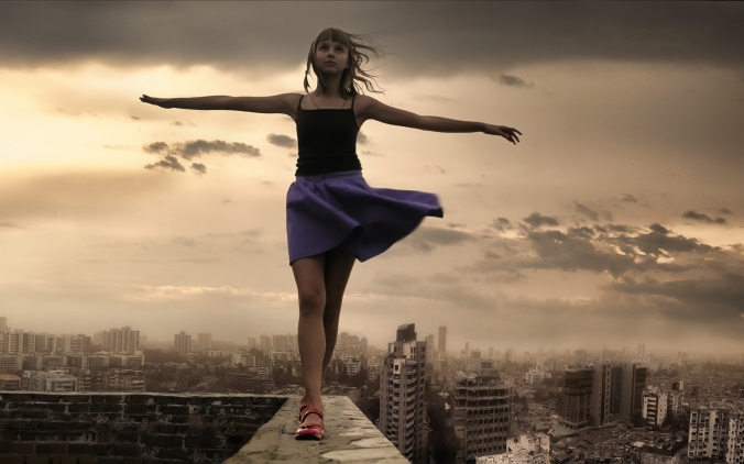 girl-walking-on-roof-edge